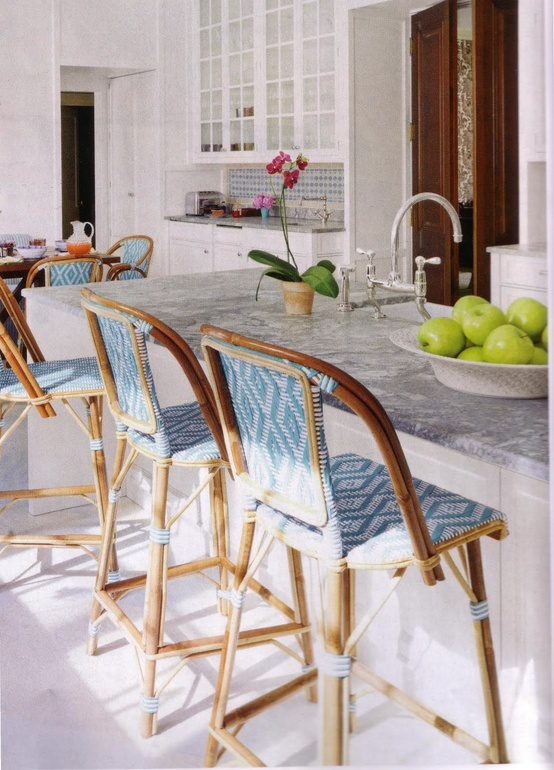 Bistro chairs with island marble top. French kitchen.